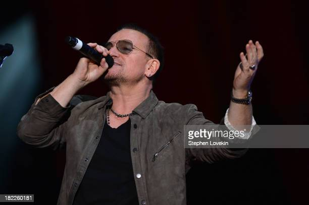 Bono appears on stage at the 2013 Global Citizen Festival in Central Park to end extreme poverty on September 28 2013 in New York City New York