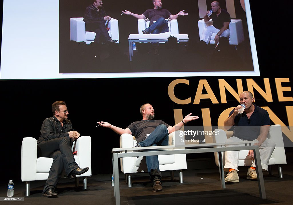 Bono attends the conversation with Sir Jonathan Ive (R) at the 2014 Cannes Lions on June 21, 2014 in Cannes, France.