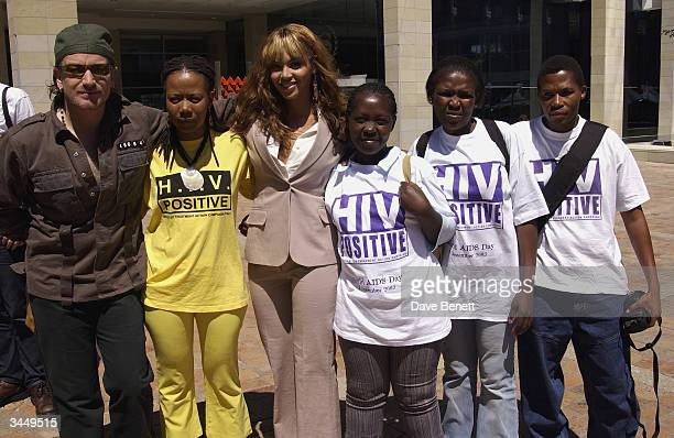 Bono Beyonce Knowles and local children attend the Nelson Mandela Foundation 46664 Photocall at The Arabella Sheraton Hotel on November 29 2003 in...