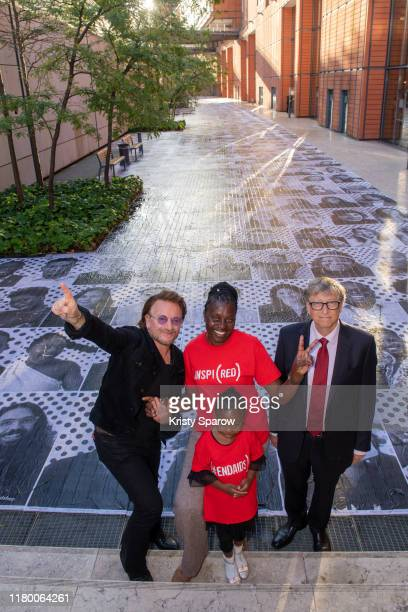 Bono, Co-Founder, , AIDS activist Constance Mudenda, alongside her daughter, Lubona and Bill Gates, Co-Chair, the Bill & Melinda Gates Foundation,...