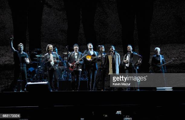 Bono Eddie Vedder Larry Mullen Jr The Edge Marcus Mumford Ted Dwane Winston Marshall Ben Lovett and Adam Clayton perform onstage during U2 'Joshua...