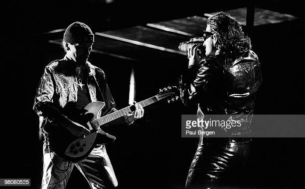 Bono films The Edge as U2 perform on stage on the Zooropa Tour at Kuip on May 10th 1993 in Rotterdam Netherlands The Edge plays slide on a...