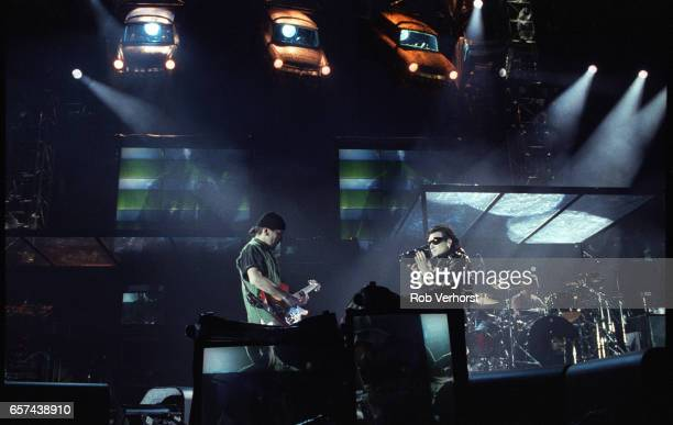 Bono films The Edge on a video camera while U2 perform on stage at Feyenoord Stadiium on the Zoo TVZooropa Tour De Kuip Rotterdam Netherlands 9th May...