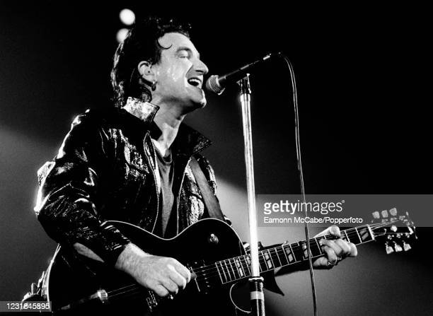 Bono, Irish musician and philanthropist, performing on stage with U2 during their Zoo TV Tour at Wembley Stadium on August 11, 1993 in London,...