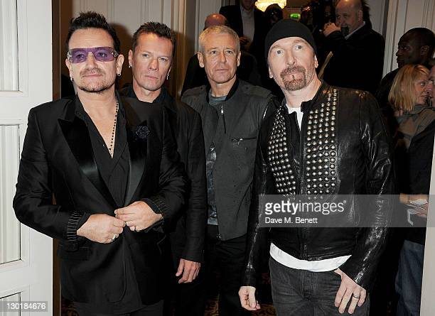 Bono Larry Mullen Jr Adam Clayton and The Edge of U2 arrive at The Q Awards 2011 at The Grosvenor House Hotel on October 24 2011 in London England