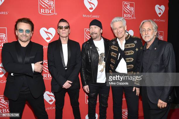 Bono Larry Mullen Jr The Edge Adam Clayton of U2 pose for the photo with President/CEO of The Recording Academy and MusicCares Neil Portnow at the...