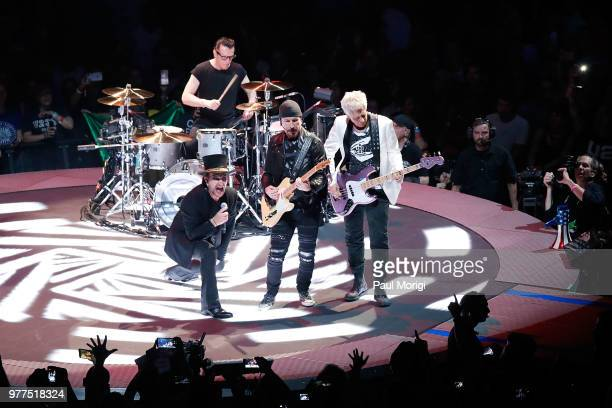 Bono Larry Mullen Jr The Edge and Adam Clayton of U2 perform during the eXPERIENCE iNNOCENCE TOUR at the Capital One Arena on June 17 2018 in...