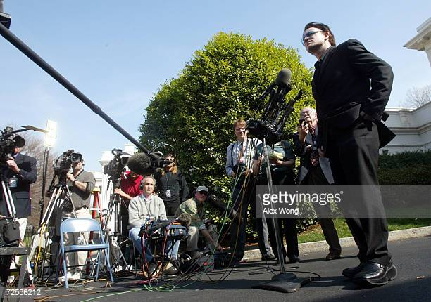 Bono lead singer of Irish pop group U2 speaks to the news media March 14 2002 at the White House in Washington DC Bono returned to the White House...
