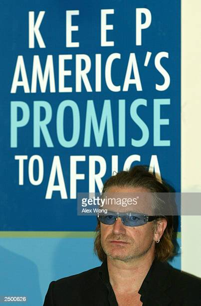 Bono lead singer of music group U2 attends a news conference on America's promise to Africa September 16 2003 in Washington DC Along with religious...