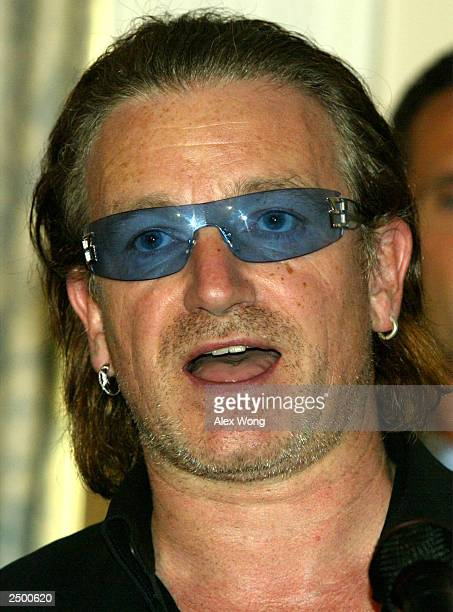 Bono lead singer of music group U2 speaks during a news conference on America's promise to Africa September 16 2003 in Washington DC Along with...