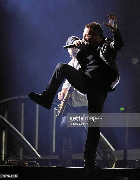 """Bono, lead singer of the Irish rock band U2, performs during the first concert of the U2 """"360 degrees"""" world tour, linked to its new album """"No Line..."""