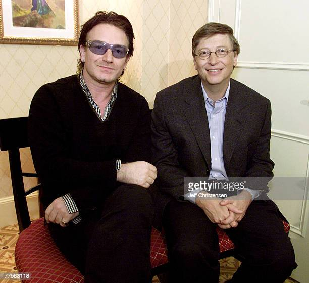 Bono lead singer of the rock group U2 and Microsoft chairman Bill Gates sit together before a news conference at the World Economic Forum in New York...