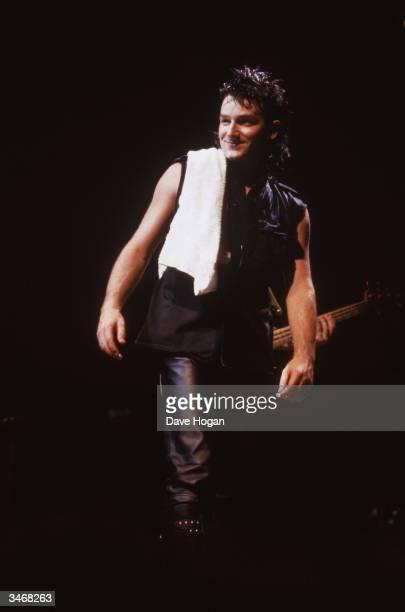 Bono lead singer of U2 in concert 1984