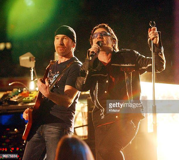Bono lead singer of U2 performs during the halftime show at Super Bowl XXXVI in the Superdome New Orleans Louisiana February 3 2002