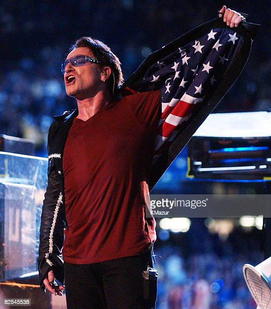 Bono, lead singer of U2, shows an American flag lining in his jacket during the halftime show at Super Bowl XXXVI in the Superdome, New Orleans,...