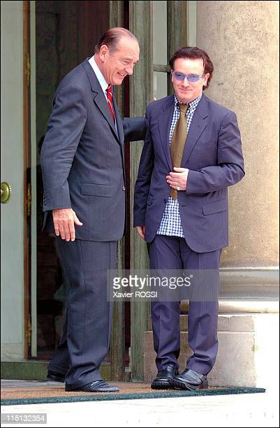 Bono of rock band U2 meets French president Jacques Chirac at the Elysee palace to ask for a French financial aid to Africa in Paris France on June...