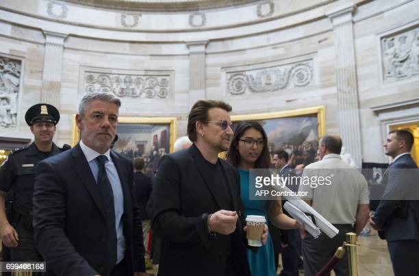 Bono of the band U2 walks through the Rotunda of the US Capitol in Washington DC June 21 between meetings with lawmakers / AFP PHOTO / SAUL LOEB