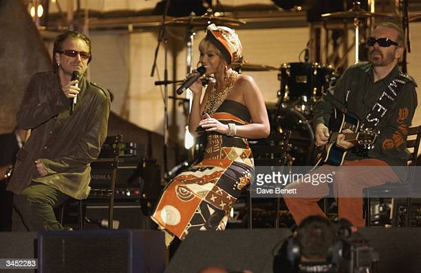 Bono of U2 and Beyonce Knowles and Dave Stewart perform at The Nelson Mandela Foundation's 46664 Give One minute to Aids Concert at The Greenpoint...