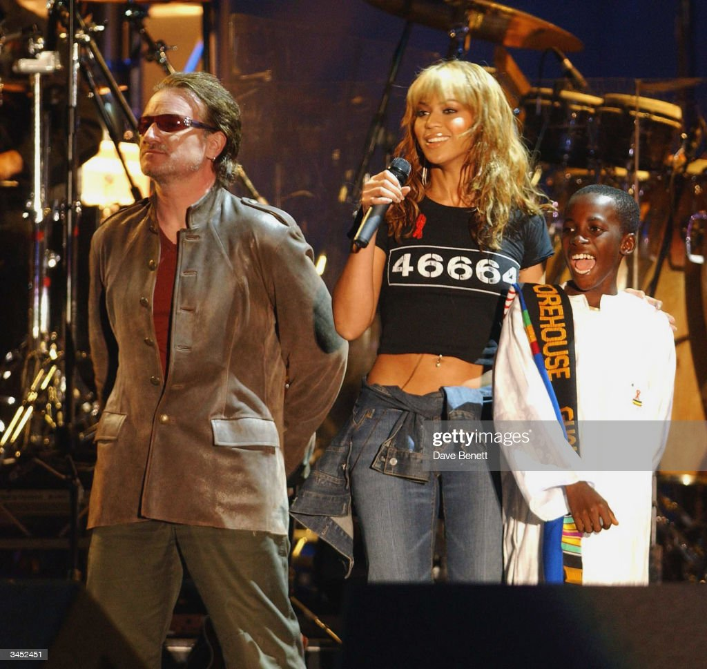 Bono of U2 and Beyonce Knowles perform at The Nelson Mandela Foundation's '46664 Give One minute to Aids' Concert at The Greenpoint Stadium on November 29, 2003 in Cape Town.