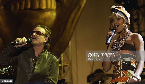 Bono of U2 and Beyonce Knowles perform at The Nelson Mandela Foundation's '46664 Give One minute to Aids' Concert at The Greenpoint Stadium on...