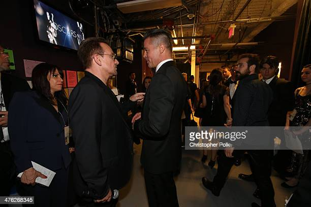 Bono of U2 and Brad Pitt speak backstage during the Oscars held at Dolby Theatre on March 2 2014 in Hollywood California