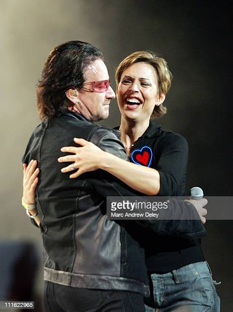 Bono of U2 and fan during U2 'Vertigo' Tour at TD Banknorth Garden in Boston October 3 2005 at TD Banknorth Garden in Boston Massachusetts United...