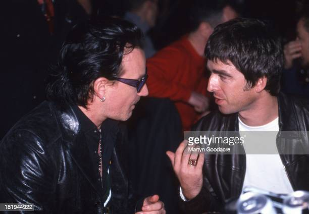 Bono of U2 and Noel Gallagher of Oasis talk at the NME awards circa 1995