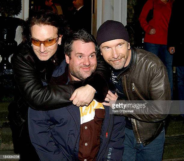Bono of U2 Chris Moyles and The Edge of U2 during U2 Take BBC Radio 1 DJs for a Ride in Dublin at Merrion Hotel in Dublin Ireland
