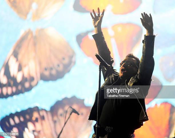 Bono of U2 headlines the Pyramid stage on the second day of Glastonbury Festival 2011 at Worthy Farm on June 24, 2011 in Glastonbury, United Kingdom.