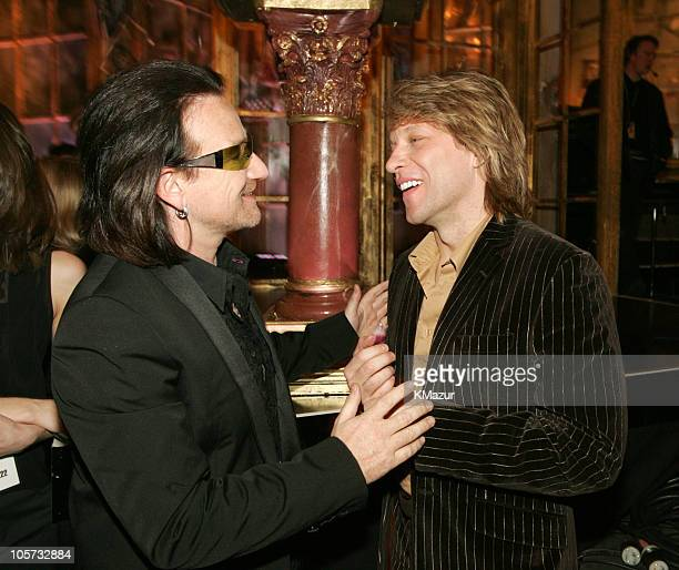 Bono of U2, inductee, with Jon Bon Jovi during 20th Annual Rock and Roll Hall of Fame Induction Ceremony - Dinner at Waldorf Astoria in New York...