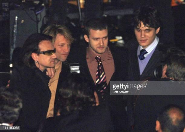 Bono of U2 inductee with Jon Bon Jovi Justin Timberlake and John Mayer