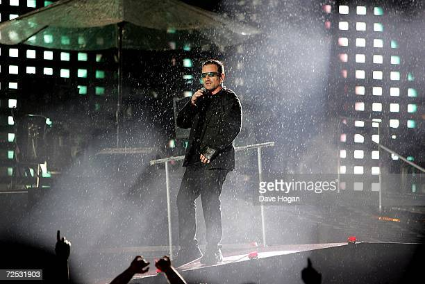 Bono of U2 is sprayed with water as he performs on stage at the first of three rescheduled Sydney dates on their Vertigo Tour at the Telstra Stadium...