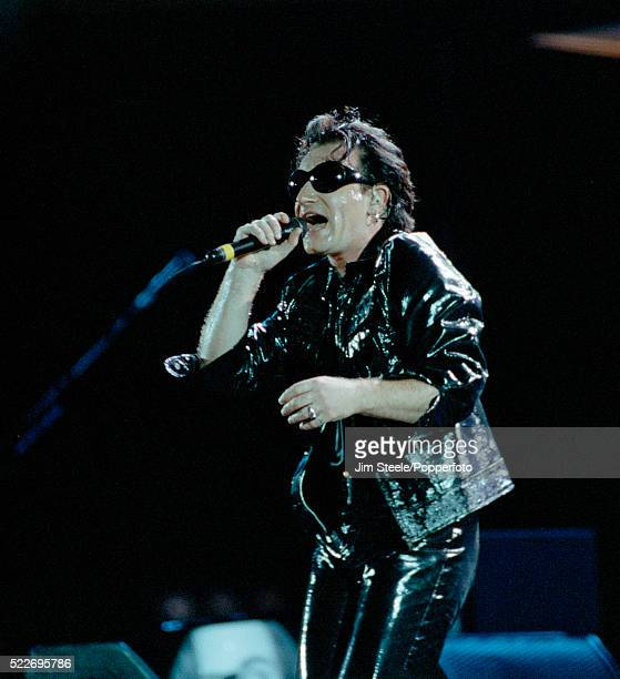 Bono of U2 performing on stage at Wembley Stadium in London circa August 1993