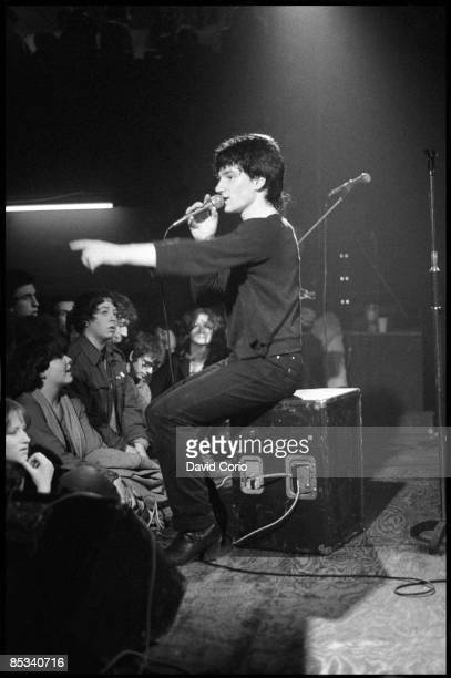 Bono of U2 performing on stage standing on box audience at the Arcadia Ballroom Cork Ireland on 1 March 1980