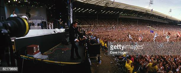 Bono of U2 performs at the Live Aid Concert at Wembley Stadium 13th July 1985