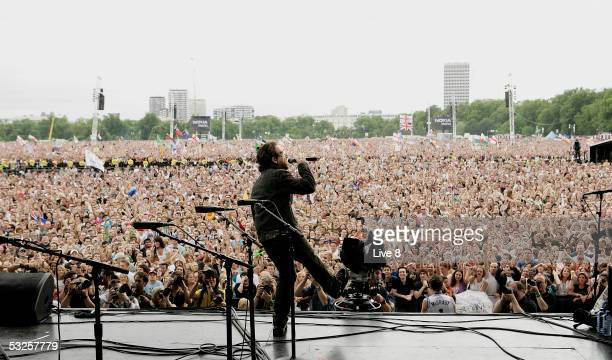 Bono of U2 performs on stage at 'Live 8 London' in Hyde Park on July 2 2005 in London England The free concert is one of ten simultaneous...