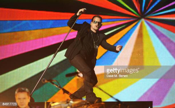 Bono of U2 performs on stage during The Brit Awards 2009 at Earls Court One on February 18 2009 in London England