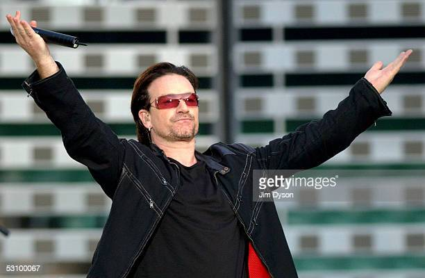Bono of U2 performs on stage on the first London night of their 'Vertigo//2005' World Tour at Twickenham Rugby Stadium on June 18 2005 in London...