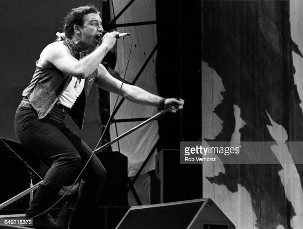 Bono of U2 performs on stage on The Joshua Tree Tour Feyenoord Stadion De Kuip Rotterdam Netherlands 10th July 1987