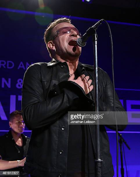 Bono of U2 performs onstage during the 3rd annual Sean Penn Friends HELP HAITI HOME Gala benefiting J/P HRO presented by Giorgio Armani at Montage...