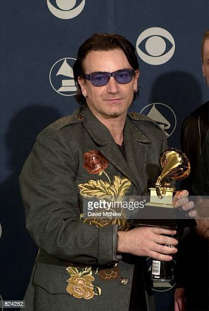 Bono of U2 poses backstage with his award at the 43rd annual Grammy Awards February 21 2001 at Staples Center in Los Angeles CA U2 won three Grammys...