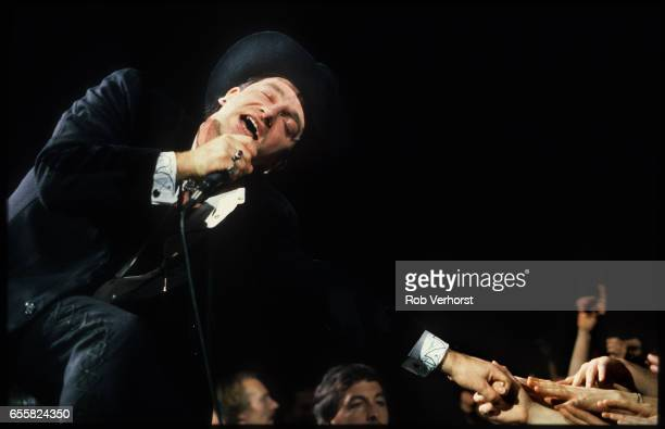 Bono of U2 reaches out hands to the crowd while performing on stage on LoveTown Tour, Ahoy, Rotterdam, Netherlands, 7th January 1990.