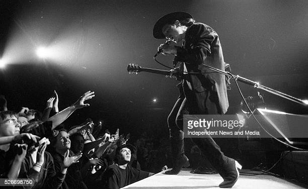 Bono onstage, performing with U2. Circa December 1989 .
