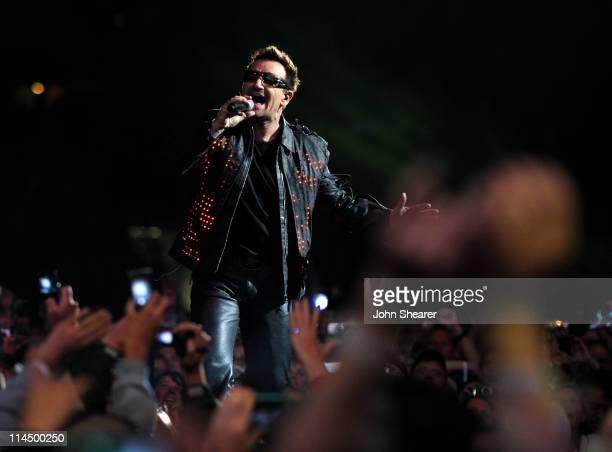 Bono performs during the U2 360 Tour at INVESCO Field at Mile High on May 21 2011 in Denver Colorado