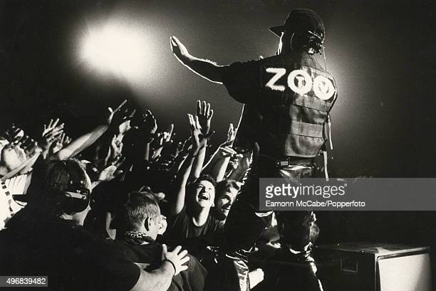 Bono of U2 performs on stage in front of cheering fans on the Zoo TV tour at Wembley Stadium London August 1993