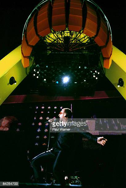 Bono performs with U2 during opening night of the 'Pop Mart' tour at Soldier Field in Chicago