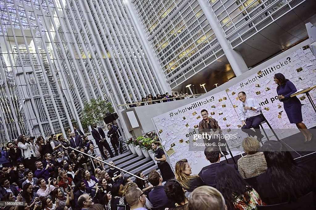 Bono, President of the World Bank Jim Yong Kim and Isha Sesay speak at the World Bank on November 14, 2012 in Washington, DC.