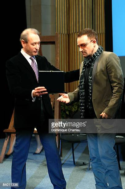 Bono receives the Peace summit award 2008 from the mayor of Paris Bertrand Delanoe during the 9th Nobel Peace Prize World Summit at the Hotel de...