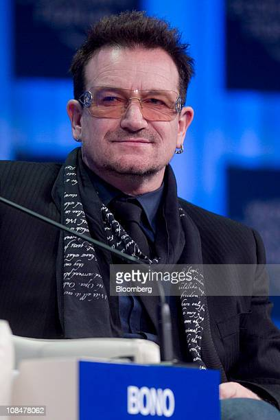 Bono singer for the band U2 listens during a session on the third day of the World Economic Forum Annual Meeting 2011 in Davos Switzerland on Friday...