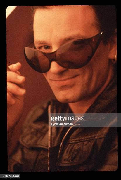 Bono singer for the rock group U2 looks at the camera through a pair of big sunglasses
